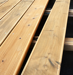 Decking boards laid out in the sun