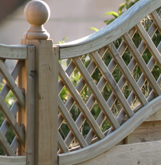 Image of trellis fencing top on lap panel fence